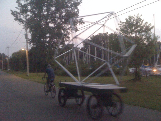 Towing a deathtrap around the island by bicycle and mailcart